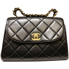 Chanel Classic Black Quilted Lambskin Gold Chain Handle Handbag