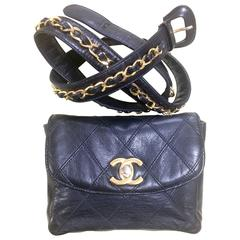 Vintage CHANEL black leather waist purse, fanny bag with golden chain belt.