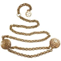 Vintage CHANEL golden nice and heavy chain belt with two large CC round charms.