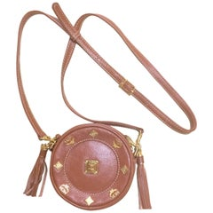 Vintage MCM brown leather round  mini Suzy Wong shoulder bag with fringes.