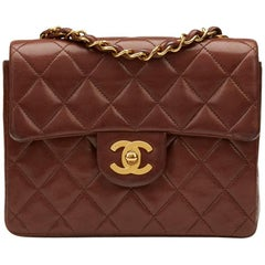 1990s Chanel Brown Quilted Lambskin Vintage Mini Flap Bag