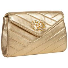 CHANEL Clutch in Gold Quilted Lamb Leather