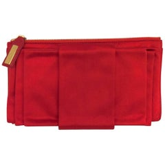 Very Valentino Red Satin Clutch With Signature Bow and Zippered Closure