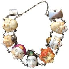 Toshikane Seven Lucky Gods Bracelet. Porcelain and Silver. 1940's.