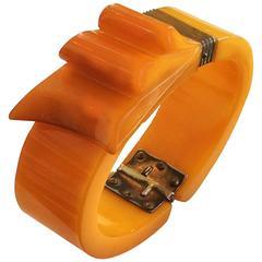 Art Deco Orange Bakelite ribbon clamper or hinged bangle