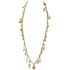 V long matt gilt 'gardening' charm necklace, Karl Lagerfeld, 1990s