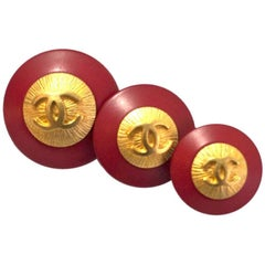 Chanel Set of Three Graduated Red and Goldtone CC Buttons