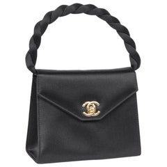 Mini CHANEL Couture Flap Bag in Black Silk Satin.