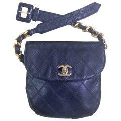 Vintage CHANEL dark navy leather waist purse, fanny pack with golden chain belt.