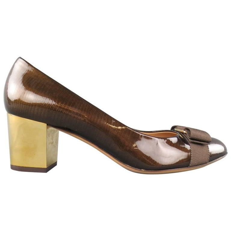 SALVATORE FERRAGAMO Size 9 Brown Lizard Patent Leather Gold Heel Bow Pumps For Sale