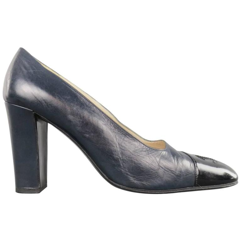 63673a64342 Vintage CHANEL Size 7.5 Navy and Black Leather Cap Toe Pumps at 1stdibs