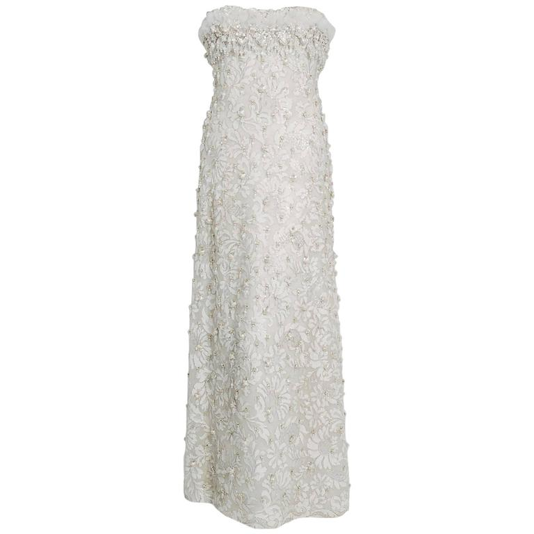 1963 Pierre Balmain Haute Couture Ivory Beaded Metallic Lace Strapless Gown For Sale