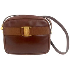 Vintage Salvatore Ferragamo vara collection brown leather purse with logo motif.