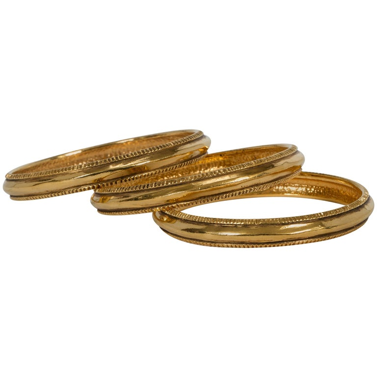 Vintage Chanel Gold Plated Bangle Bracelets - Set of 3 For Sale
