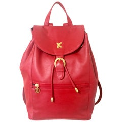 Vintage Paloma Picasso red leather backpack with golden logo motifs. Classic bag