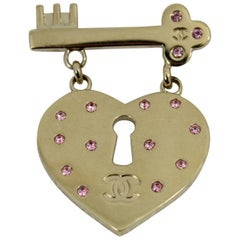 Chanel Lovely Heart and Key Brooch with pink stones.
