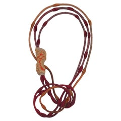 Short Golden Lava Cocoon Necklace with 2 Red and 1 Orange Cord