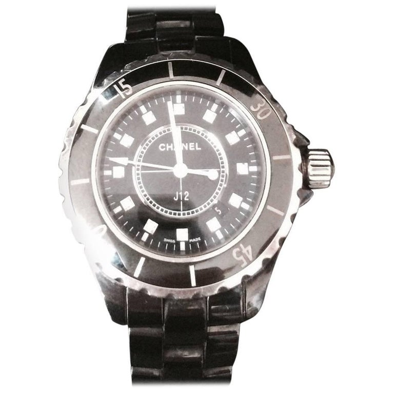 Chanel J12 Black Ceramic Automatic Watch H1626  with original box, certificate from Chanel- and band. The watch identification number is LD96570.  This Chanel J12 series watch constructed from scratch resistant high-gloss black ceramic case with a