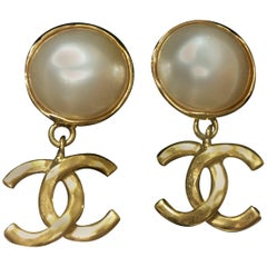 MINT. Vintage CHANEL white faux pearl and golden dangling earrings with CC mark.