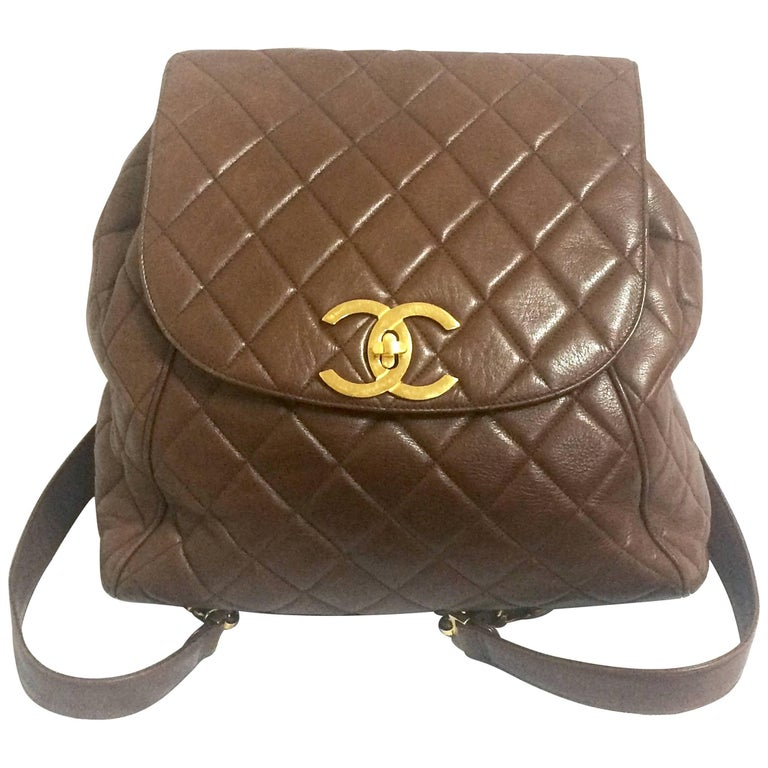 Vintage CHANEL quilted brown lamb leather backpack with gold chain and large CC. For Sale