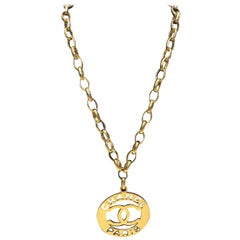 Chanel Gold Plated Logo Medallion Necklace