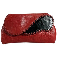 Red Leather Whip Stitched Enamel Clutch, circa 1980