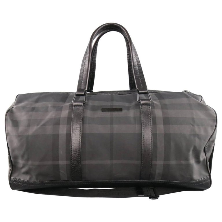 f28bad10d2de BURBERRY Black and Grey Plaid Nylon and Leather Large Duffle Bag at ...