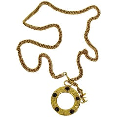 Chanel Vintage Gold Toned and Ruby Gripoix Magnifying Glass Pendant Necklace