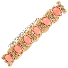 A rusticated gilt metal and faux coral bracelet, Panetta, 1960s.