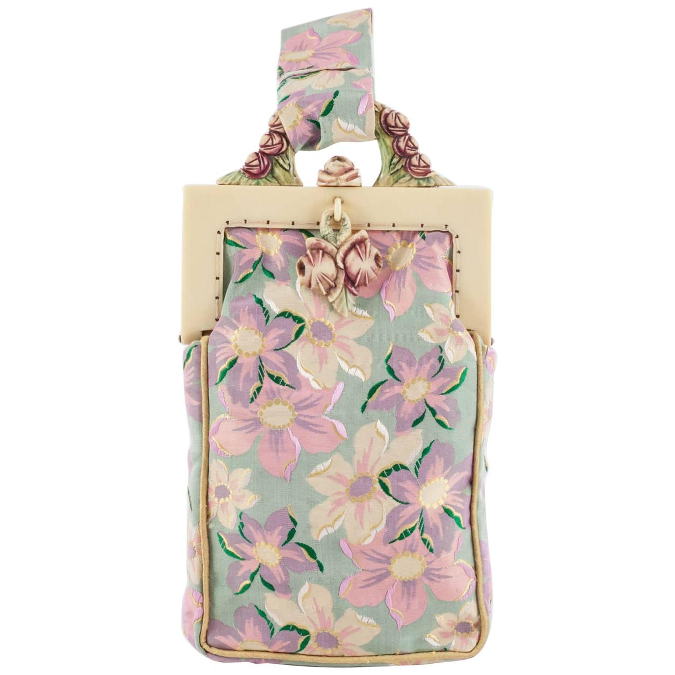 An embroidered floral silk and ivorine framed small handbag, English, 1920s.