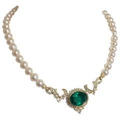 MINT. Vintage Nina Ricci faux pearl necklace with green Swarovski pendant top.
