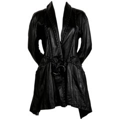 Issey Miyake draped black leather jacket with whipstitch trim, early 1980s