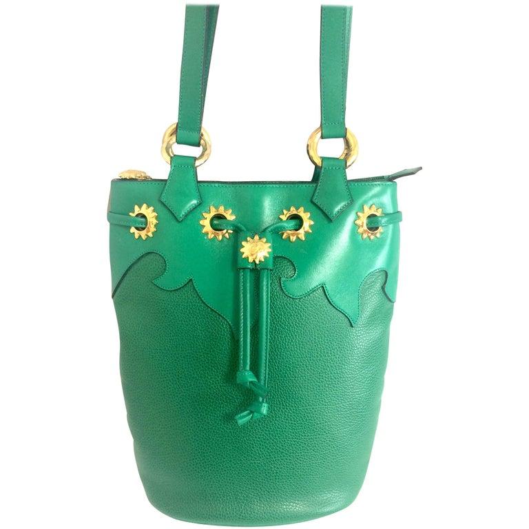 Vintage Christian Lacroix green hobo bucket shoulder bag with golden star motifs