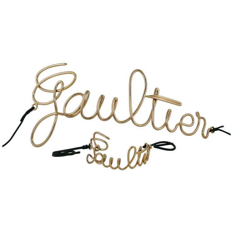 Jean Paul Gaultier Cursive Logo Copper Toned Belt and Bracelet Set
