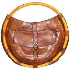 Rare and Large Circular Architectural Bamboo and Leather Purse FALL