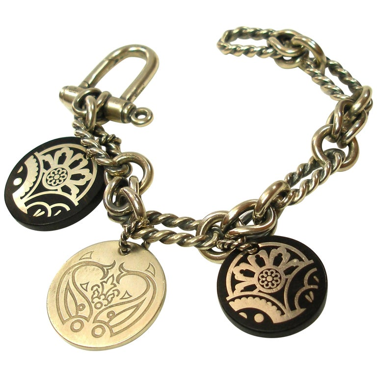 ea4d40a7b VINTAGE GUCCI SILVER and WOOD CHARM BRACELET / RARE For Sale at 1stdibs
