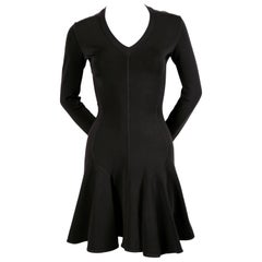 Azzedine Alaia black skater dress with v-neckline and long sleeves, 1990s