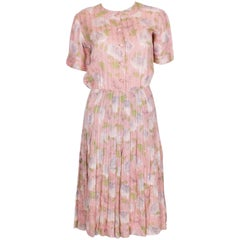 A vintage 1940s floral print, pink summer cotton day dress