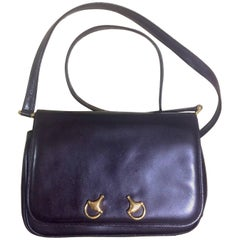 Vintage Gucci dark brown leather classic shoulder bag with 2 horsebit motifs.