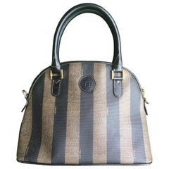 Vintage FENDI classic black and grey pecan vertical stripe bolide shape handbag.