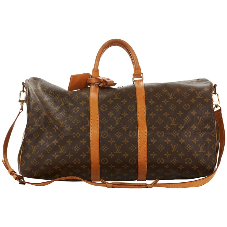 9b4a3a35b910 1988 Louis Vuitton Brown Coated Monogram Canvas Vintage Keepall Bandouliere  55 at 1stdibs