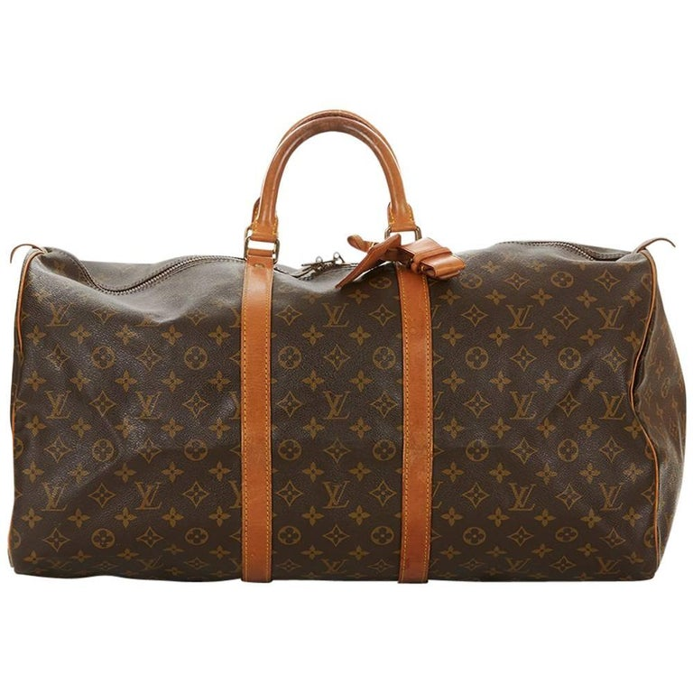 1987 Louis Vuitton Brown Coated Monogram Canvas Vintage Keepall 55  For Sale