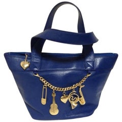 Vintage Moschino navy blue leather classic tote bag with golden dangling charm.
