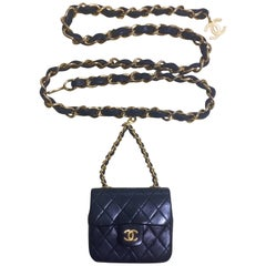 Vintage CHANEL black lambskin mini 2.55 bag charm chain leather belt with CC.