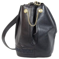 Gianni Versace 1980s vintage bucket bag Crossbody dark blu golden chains logo