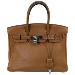 Hermes Birkin 30 Bag in Gold Leather with padlock and keys Fair condition.