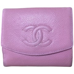 Vintage CHANEL milky pink caviar leather wallet with stitched CC mark. Classic.