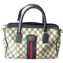 Gucci 1980s Logo Canvas Shoulder Bag.