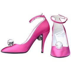 Charles Jourdan fuchsia satin pumps decorated with a transparent sphere.