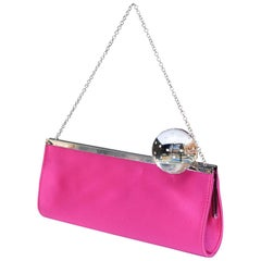 Charles Jourdan evening clutch made of fuchsia satin and transparent sphere